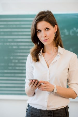 female-teacher-or-student-with-a-phone-at-PLUZ63L.jpg